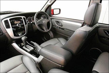 mazda在中国现地生产汽车之始,是由海南马自达汽车生产323高清图片